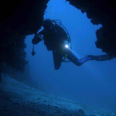 Scuba diver in a cave opening in Croatia